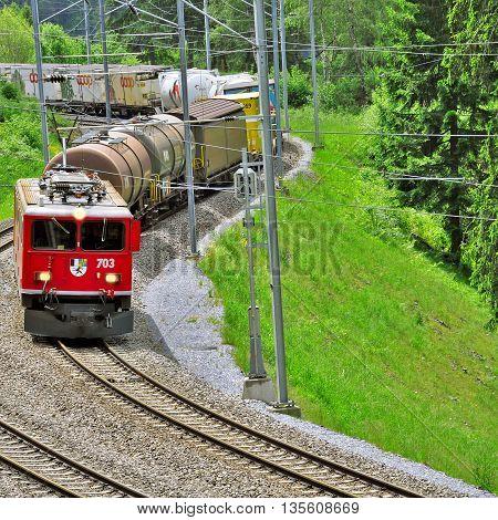 Filisur Switzerland - June 08 2010: Freight train from St. Moritz moves towards Chur.