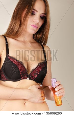 Woman Applying Moisturizing Body Oil Lotion