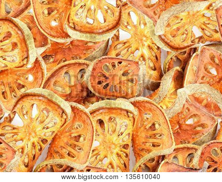 a lot of sliced dried bael fruits