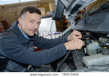 man is reparing car