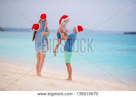 Young happy family on beach exotic vacation