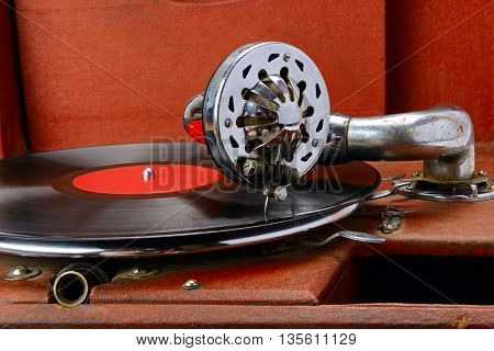 Vintage gramophone with vinyl disc. Close-up.