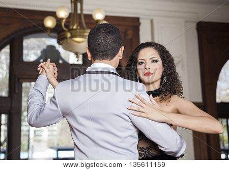 Pretty Woman Performing Tango With Man In Restaurant