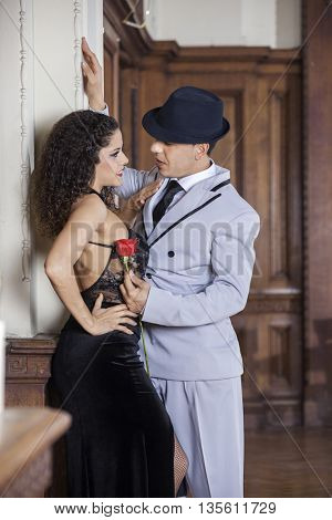 Tango Dancer Holding Rose While Looking At Female Partner