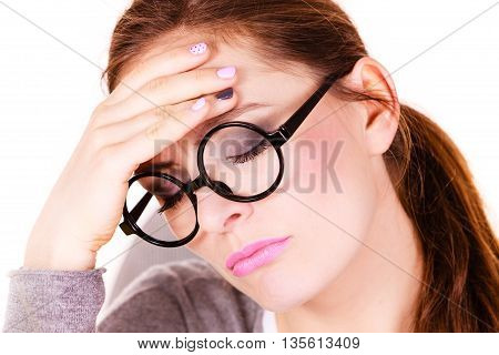 Woman tired businesswoman overworked young female suffering from head pain isolated on white. Headache migraine and stress