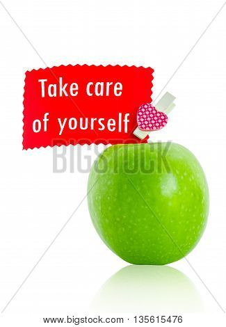 Take care of yourself card with green apple isolated on white background Save clipping path. Healthy concept.