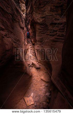 Girl Backpacker Exploring Little Wild Horse Canyon Utah
