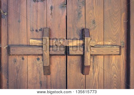 Closed Wooden Door With Locking Bar , Vintage
