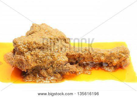 Curry Lamb shank whole roasted lamb leg on white background