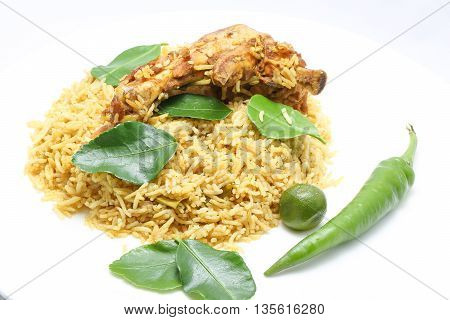 Chicken Biryani Lemon Lime Leaf with chicken piece on white background