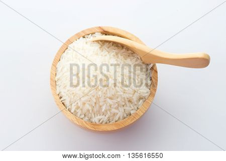 wooden bowl of jasmine rice grain on white background