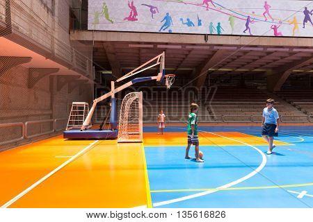 SAO PAULO, BRAZIL - CIRCA MAY 2016: Boys playing soccer on indoors