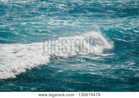 Close up view of beautiful blue ocean wave with white foam in Bali