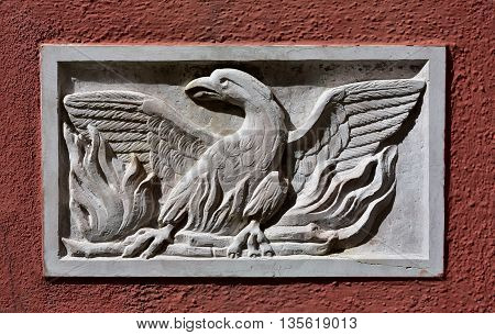 Old Patera (Venice public art) with phoenix theatre symbol on a wall near the famous opera house