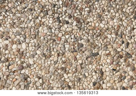 Pea gravel that makes up a pool deck.