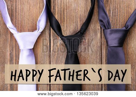 Happy father's day concept. Trendy ties on wooden background
