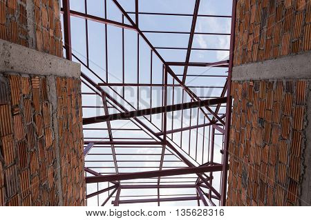 Structural Steel Beam On Roof And Brick Wall Of Building Residential Construction