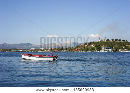 Trinidad Cuba - January 11 2016: Man in small fishing boat. Larger fishing boats are not allowed on Cuba because of the risk of island people sailing to the United States