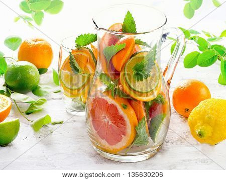 Pitcher And Glass With Citrus Fruits And Mint Leaves.