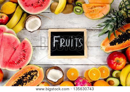 Mix Fresh Tropical Fruits Background.