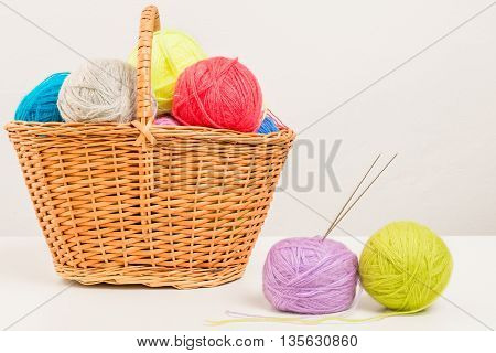 Wicker Basket Packed Full Of Skeins On White Table