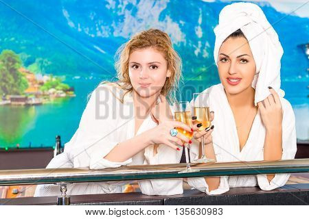 Young Cute Girlfriend With Glasses Of Champagne In Robes
