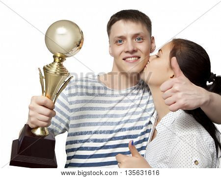 Man holding up a gold trophy cup as a winner in a competition isolated on white