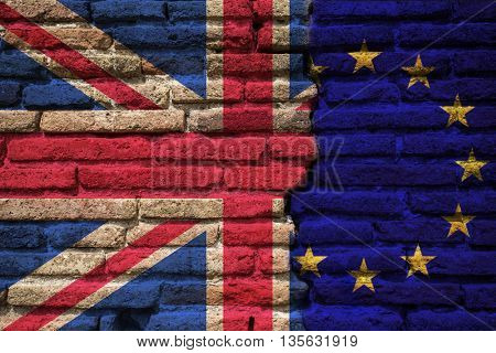 Flags of UK and EU painted on cracked brick wall