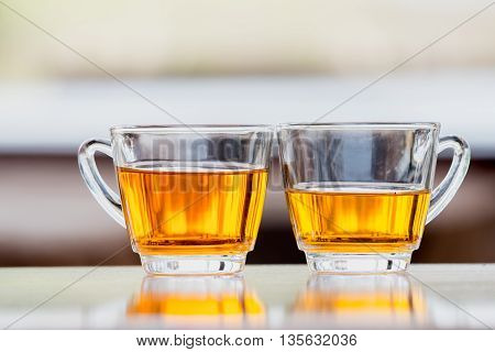 close up Tea glasses on a wooden table.