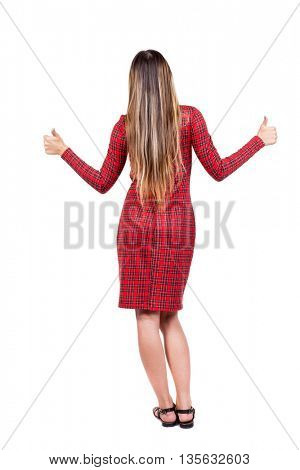 Back view of  woman thumbs up. Rear view people collection. backside view of person. Isolated over white background. The girl in red plaid dress shows thumbs up.