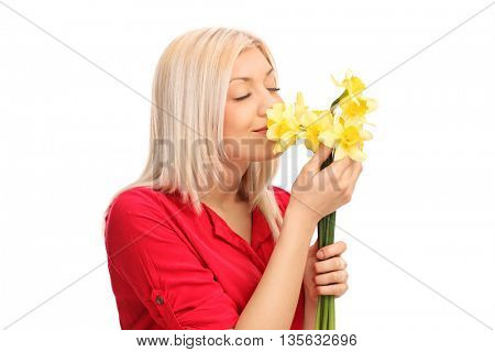 Blond woman smelling a bunch of yellow tulips isolated on white background
