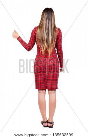 Back view of  woman thumbs up. Rear view people collection. backside view of person. Isolated over white background. The girl in red plaid dress with your right hand thumb up.