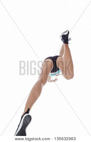 Low angle female athlete jumping on white background