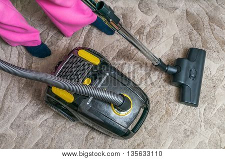 Woman Is Vacuuming Carpet With Vacuum Cleaner.
