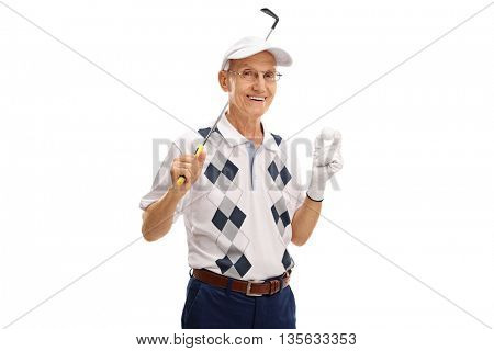 Studio shot of a senior golfer holding a golf club and a ball isolated on white background