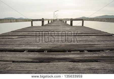 The wood bridge on the time in beautiful day, Ranong Thailand