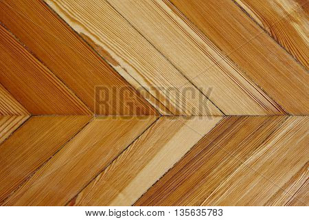 Varnished natural wooden floor detail row pieces. Parquet. Horizontal