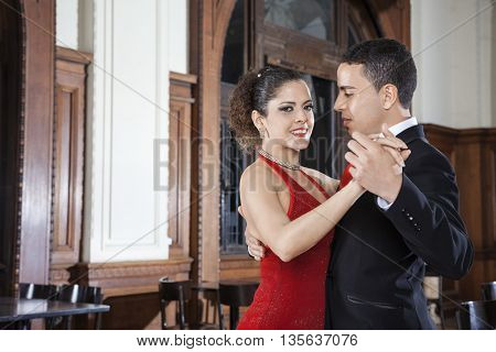 Argentine Tango Dancer With Man Performing Gentle Embrace