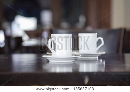 Coffee Cups Served On Table In Cafe