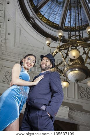 Portrait Of Tango Dancers Performing Below Cupola