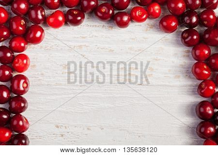 Cherries On White Wooden Table With Copyspace Available