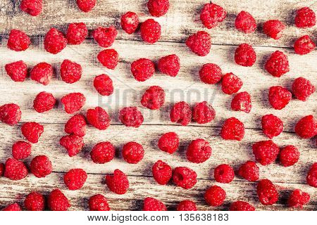 Raspberry On Wooden Table In Vintage Toning