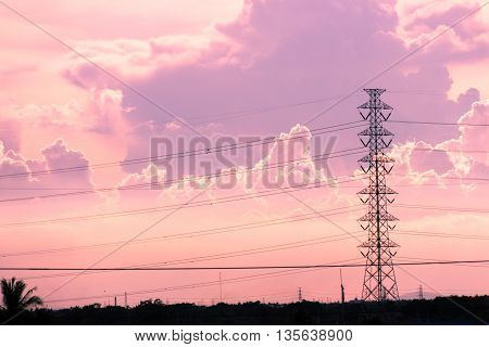 High voltage electric tower in the pink sky and cloud background
