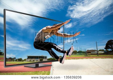 Portrait of sportsman jumping against view of running track