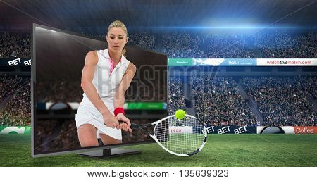 Athlete playing tennis with a racket against view of a stadium