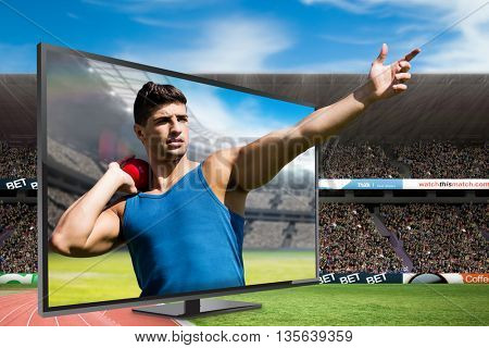 Front view of sportsman practising shot put against view of a stadium