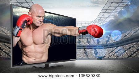 Bald boxer in fighting stance against view of spotlights