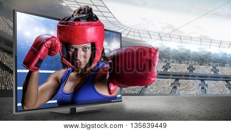 Portrait of female boxer with gloves and headgear against composite image of ring ropes