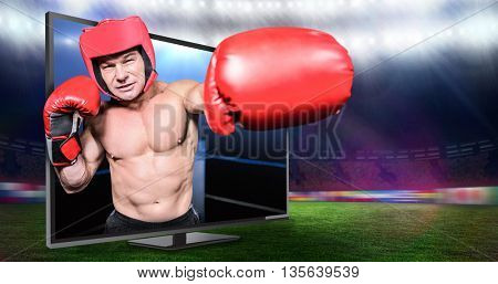 Boxer punching against black background against composite image of boxing ring