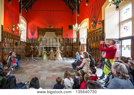 Edinburgh Scotland - July 28 2012: Performance in medieval dress in the great hall of the Royal Palace in the Edinburgh castle.